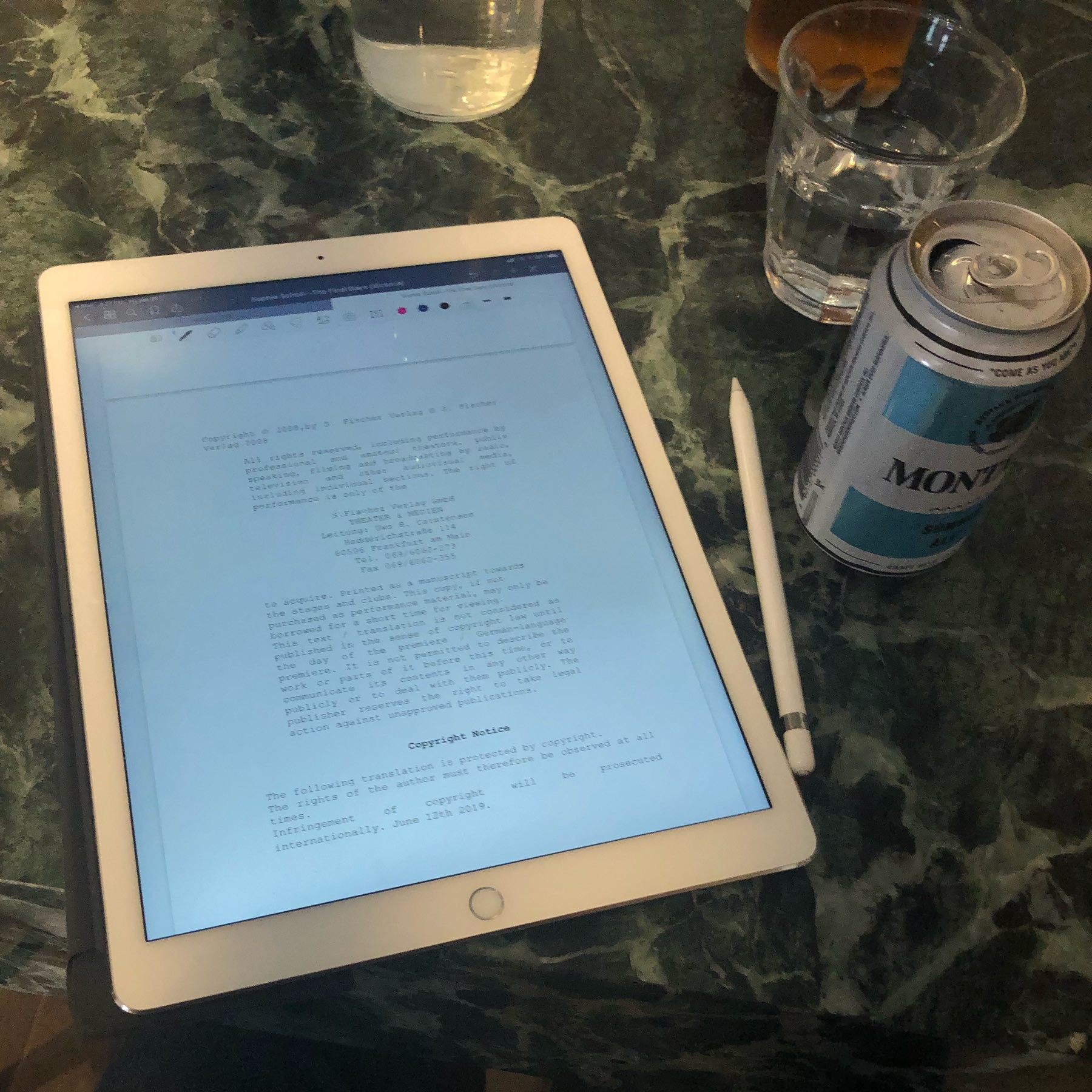 iPad with play script next to beer can