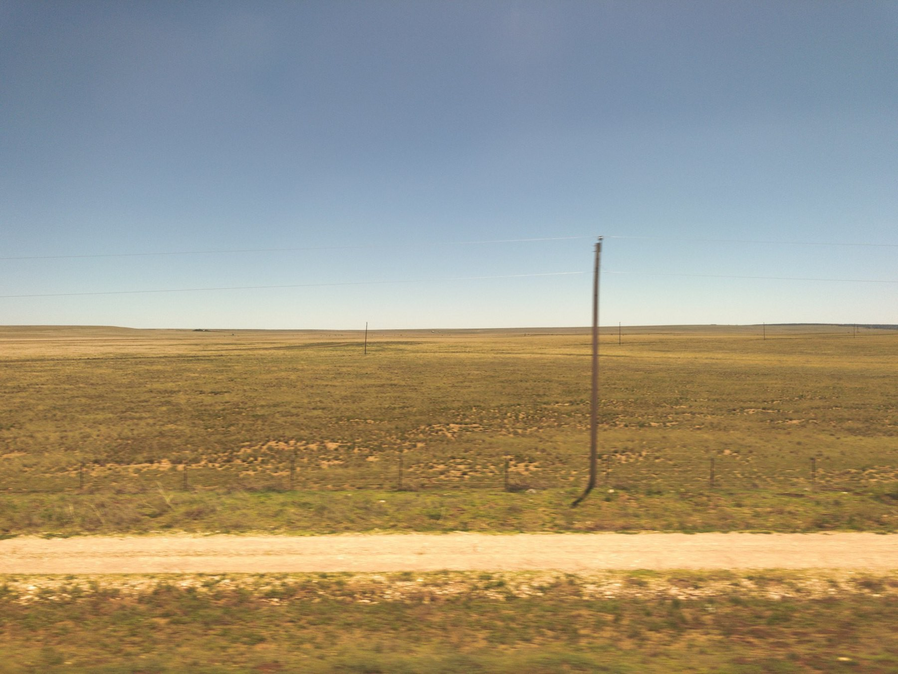 View of dry prairie from train window