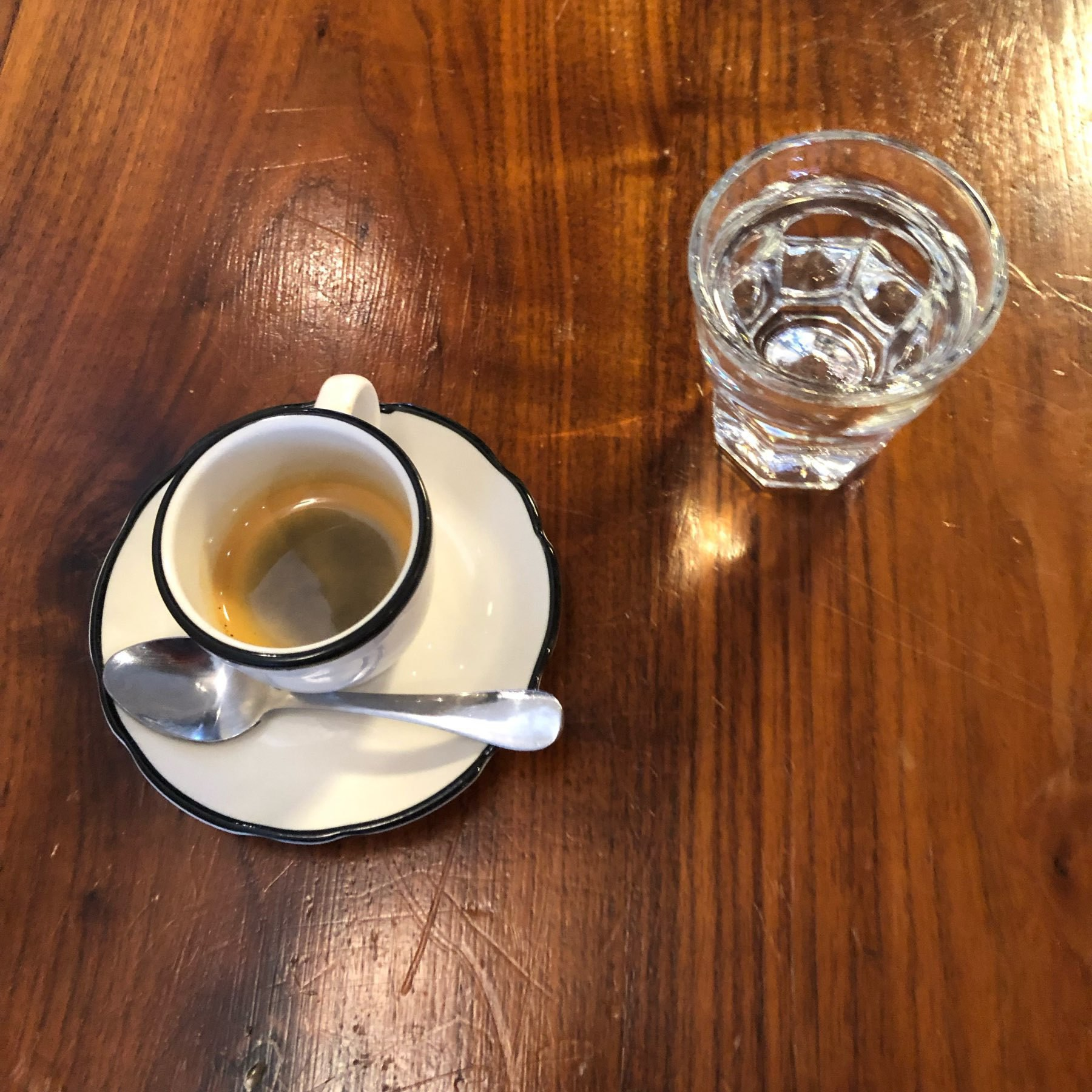 Sparkling water shot next to an espresso.