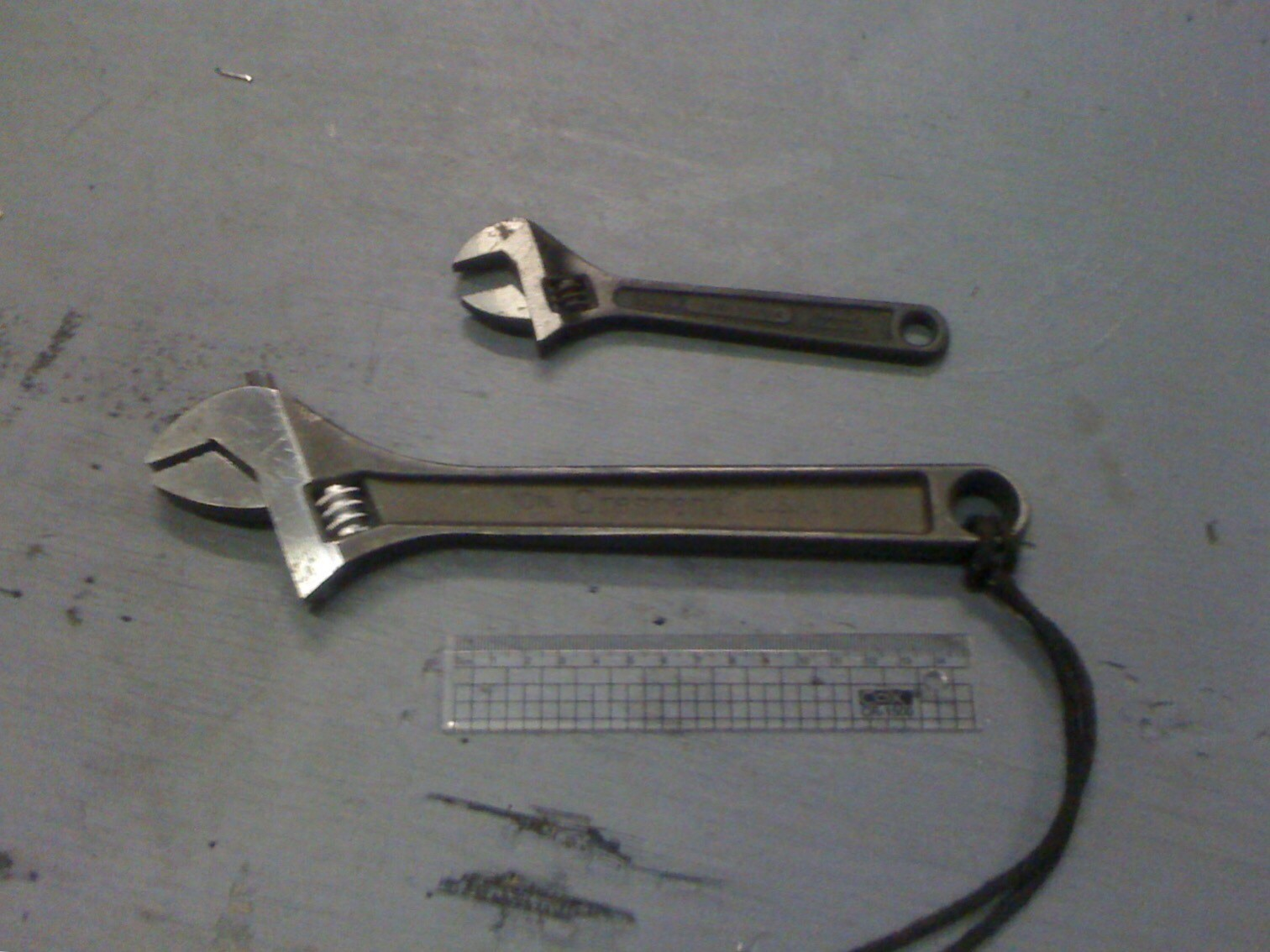 A six inch wrench above an eight inch wrench.