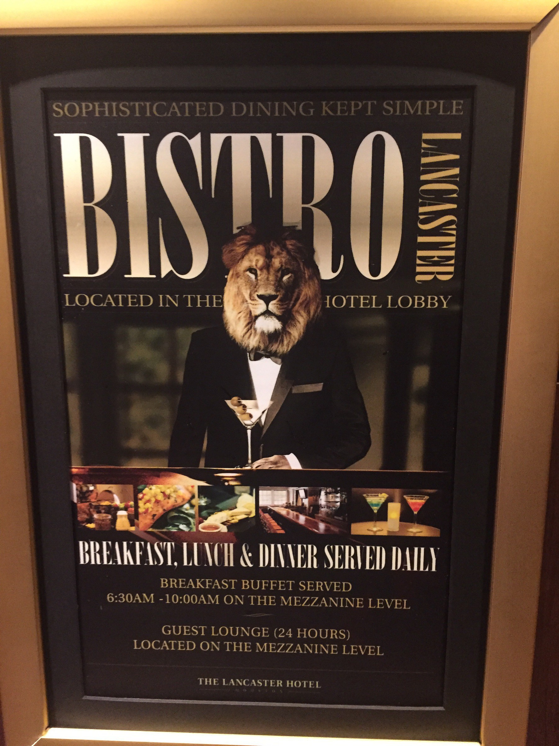 A sign advertising the Bistro Lancaster featuring a bartender with the head of a lion.